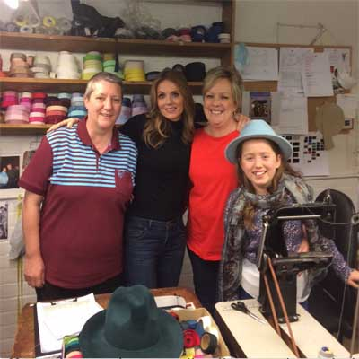 Gerry Halliwell and daughter visit Walter Wright Hat factory